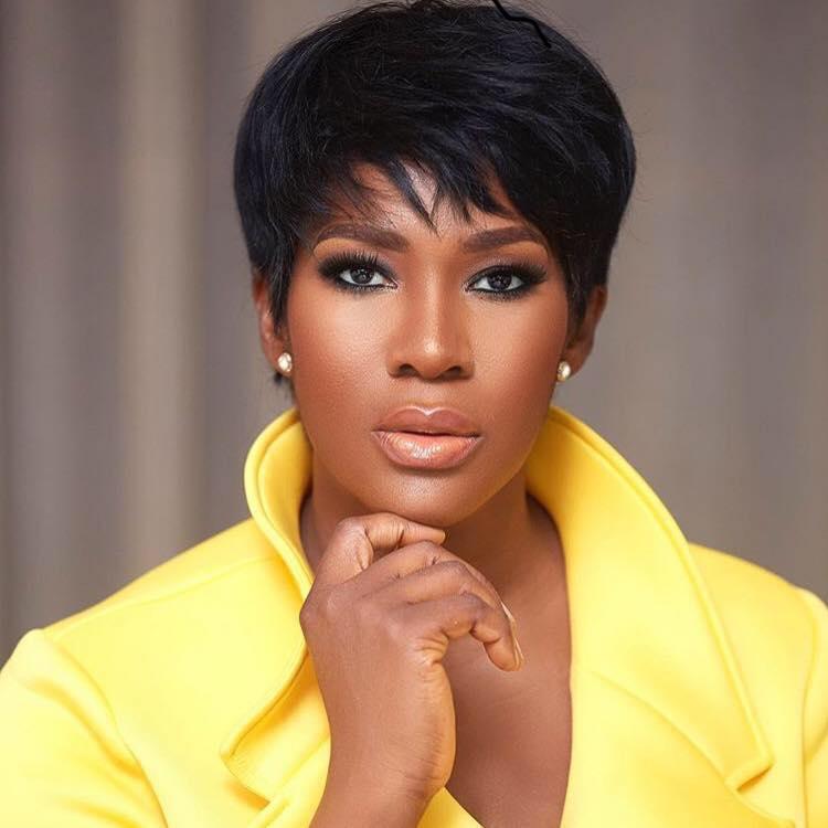 Nollywood actress Stephanie Okereke Linus in yellow fashion jacket