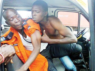 Lagos traffic fight scene. Zikoko half-naked
