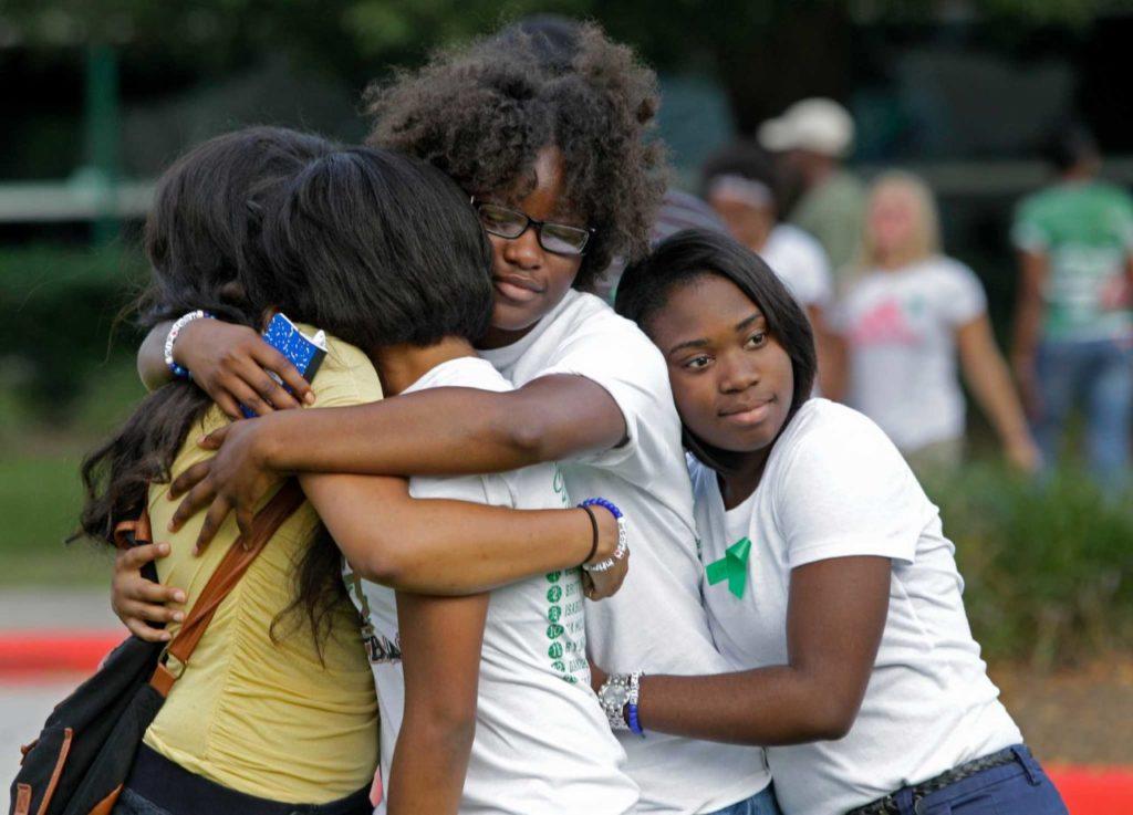 Girls hugging Job Zikoko