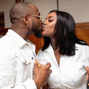 Kissing Davido and Chioma