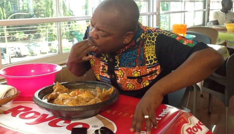 African man eating:newjob
