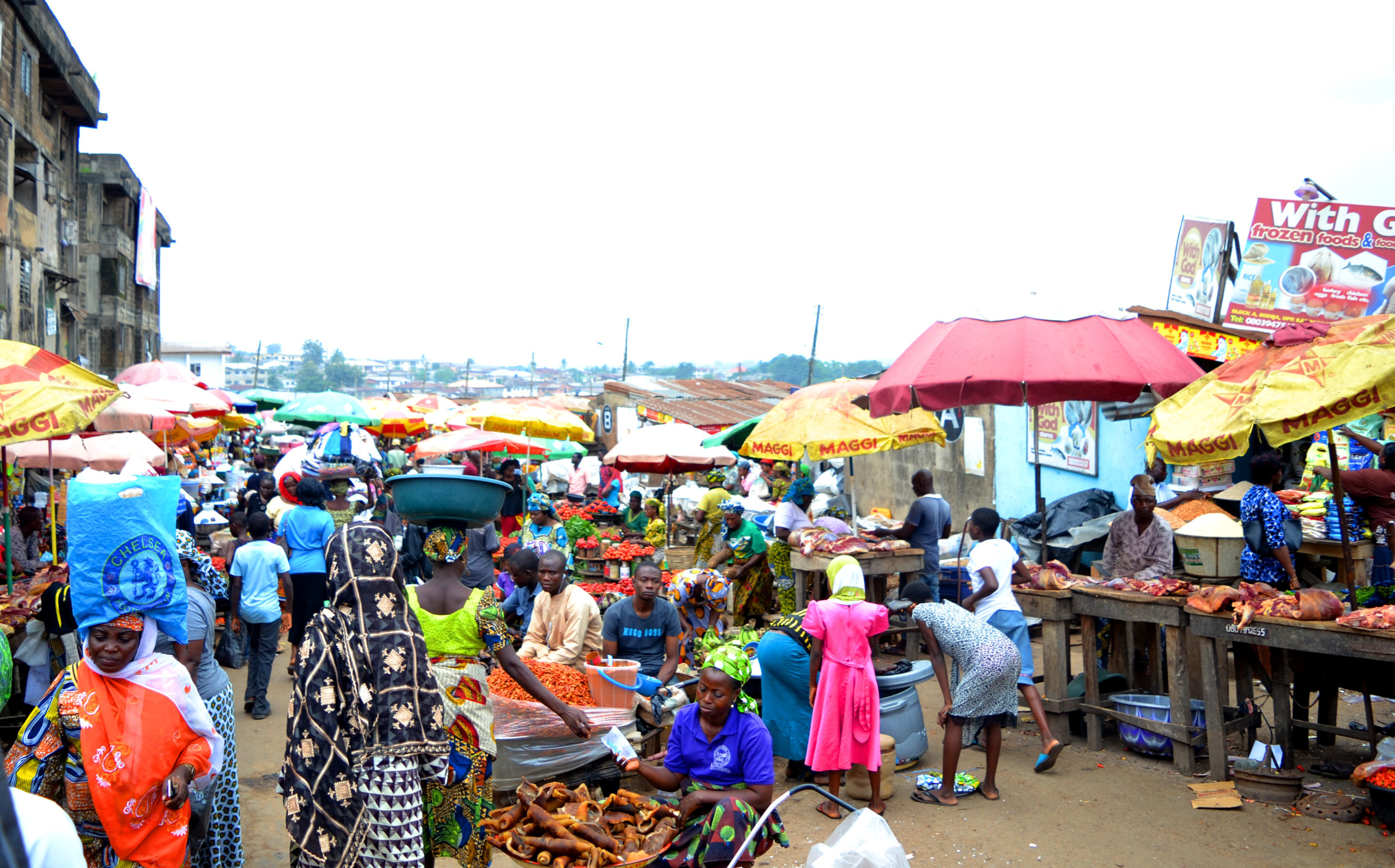 If you bend and look between you legs in a market, what will you see?