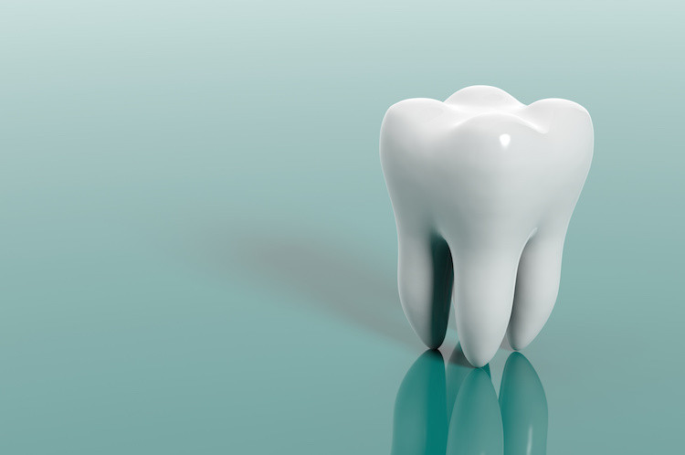 Where do you have to throw your tooth for it to grow back?