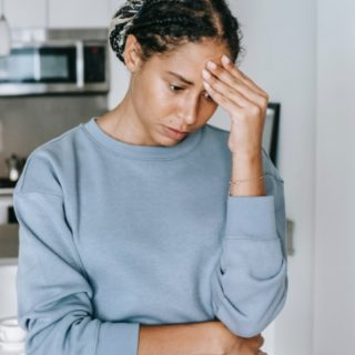 Black woman worried and anxious standing