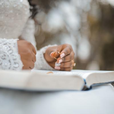 hands holding wedding ring
