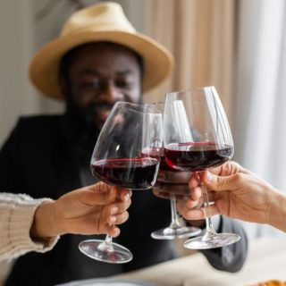 people holding wine glass