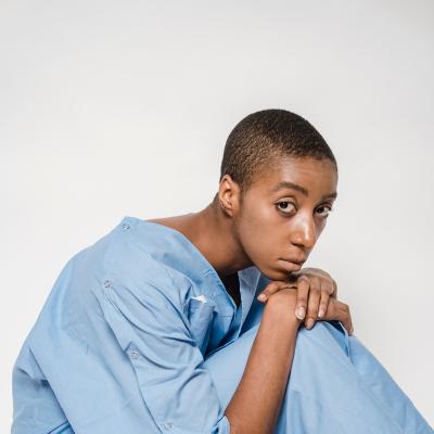 Bald woman looking sad in hospital cloth