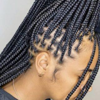 Black woman in box braids